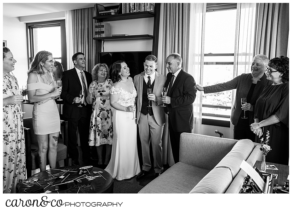 black and white photo o a bride and groom socializing with their guests at their Portland Press Hotel wedding