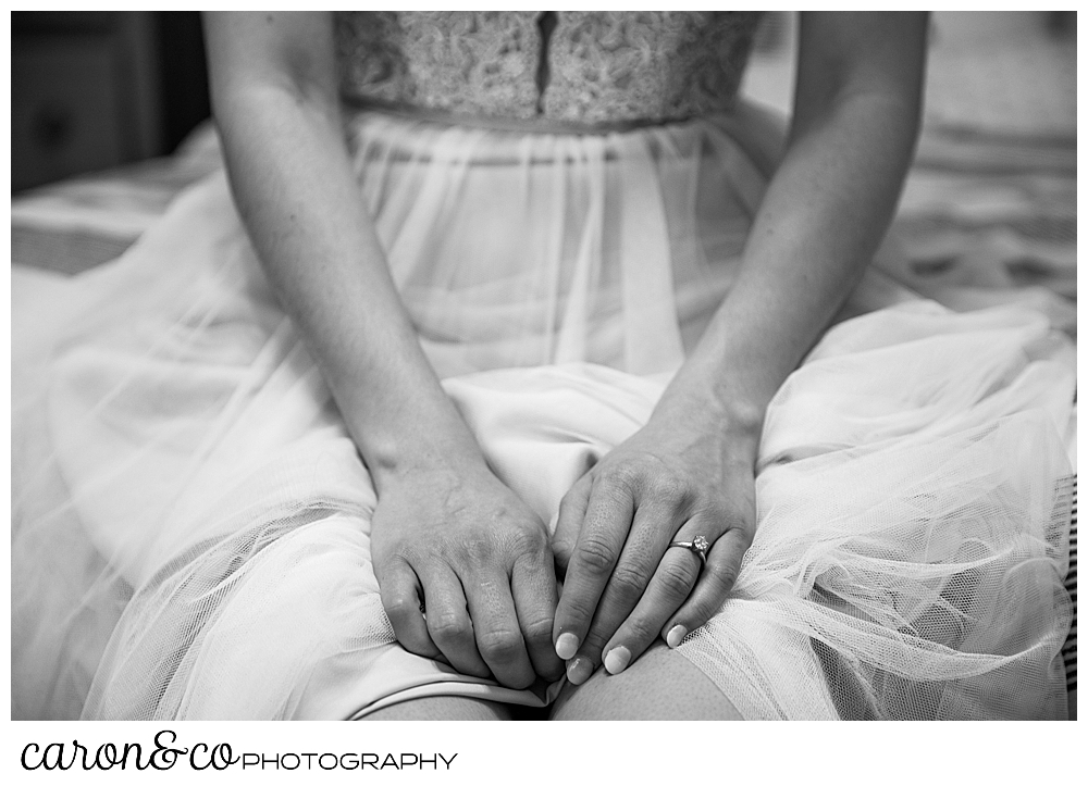 black and white photo of a bride sitting with her hands in her lap, at her sweet Portland Maine elopement