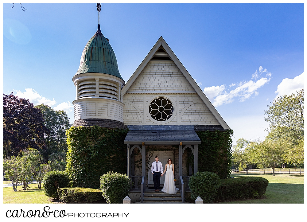 bride and groom standing on the porch of the chapel at Laurel Hill Cemetery