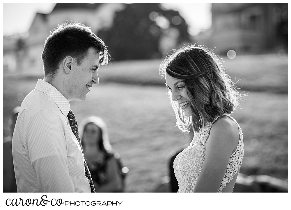 black and white photo of a bride and groom facing each other during their sweet Portland Maine elopement ceremony