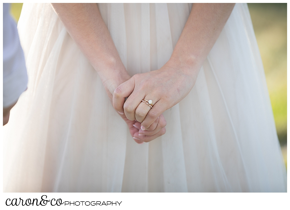 brides hands clasped during her sweet Portland Maine elopement ceremony