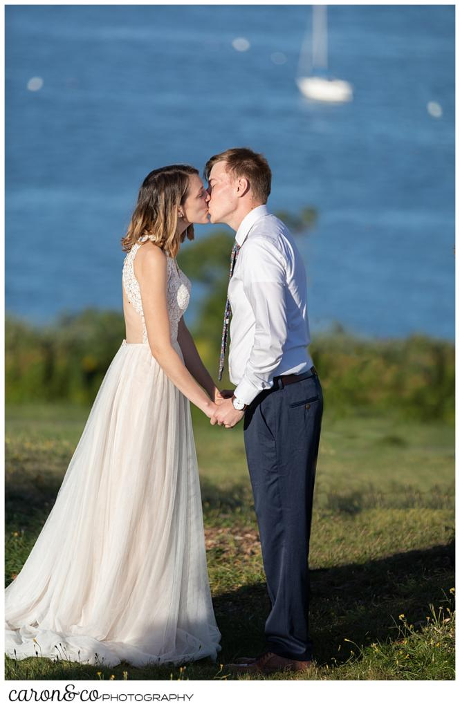 bride and groom's first kiss during their sweet Portland Maine elopement