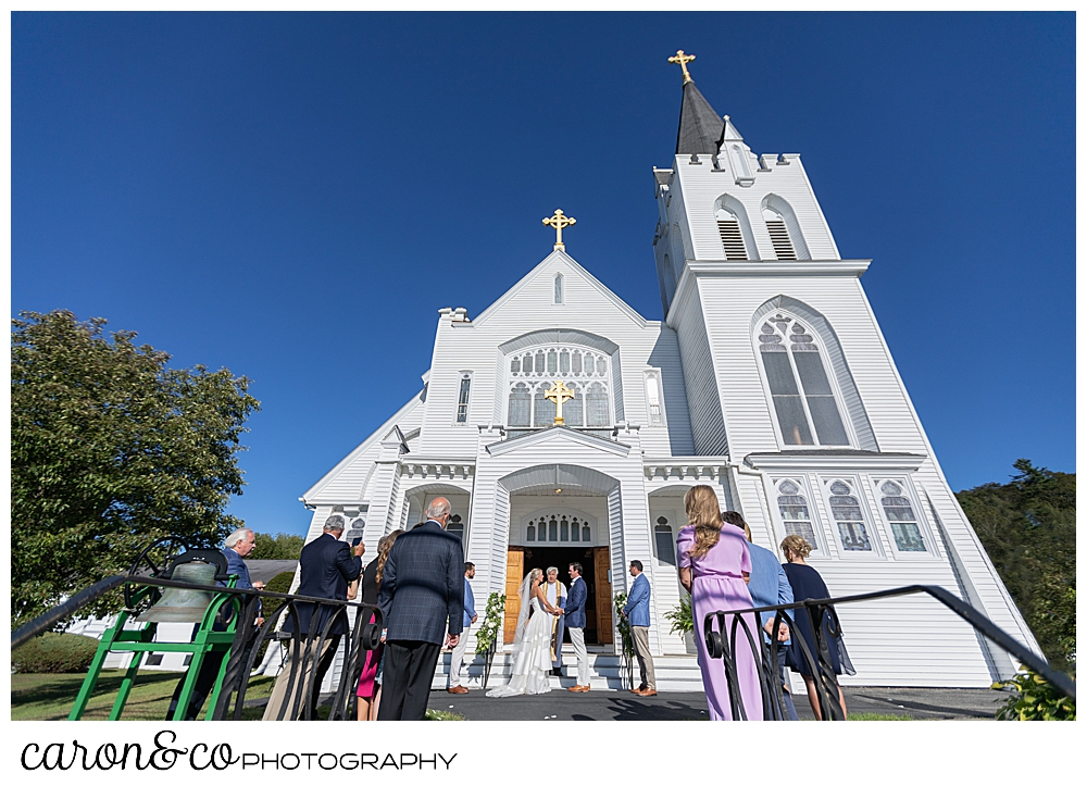 A micro wedding on the steps of Our Lady Queen of Peace Catholic Church at a timeless Boothbay Harbor wedding
