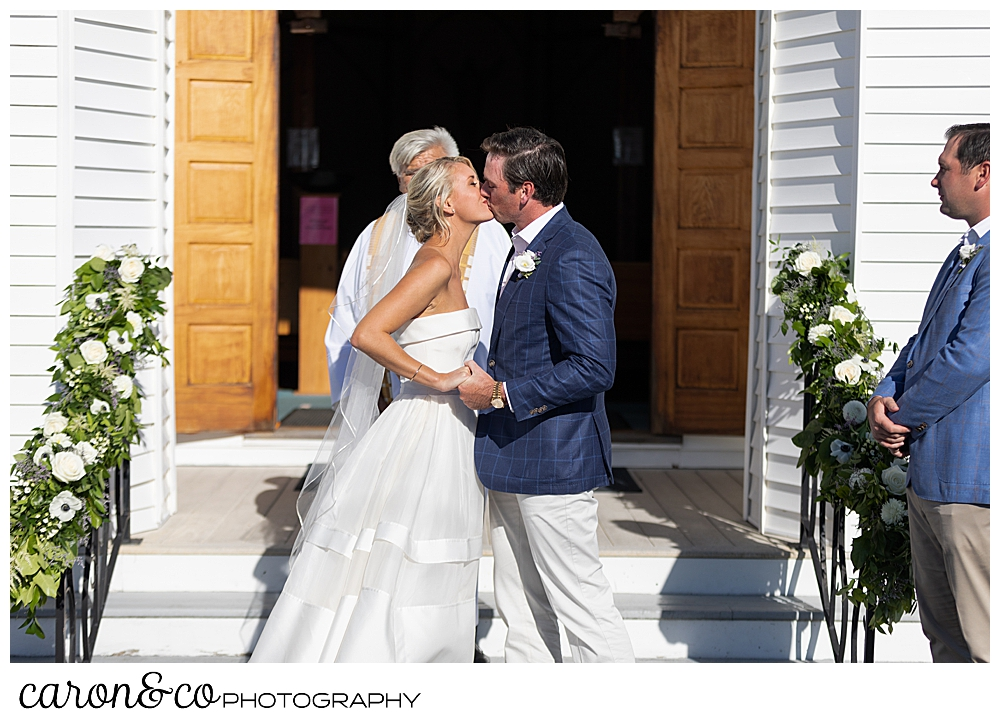 Bride and groom's first kiss at Our Lady Queen of Peace Catholic Church, Boothbay Harbor, Maine