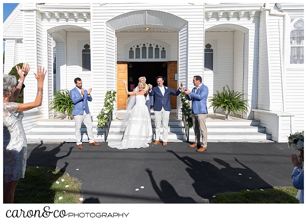 A bride and groom during the recessional at Our Lady Queen of Peace, Boothbay Harbor, Maine wedding