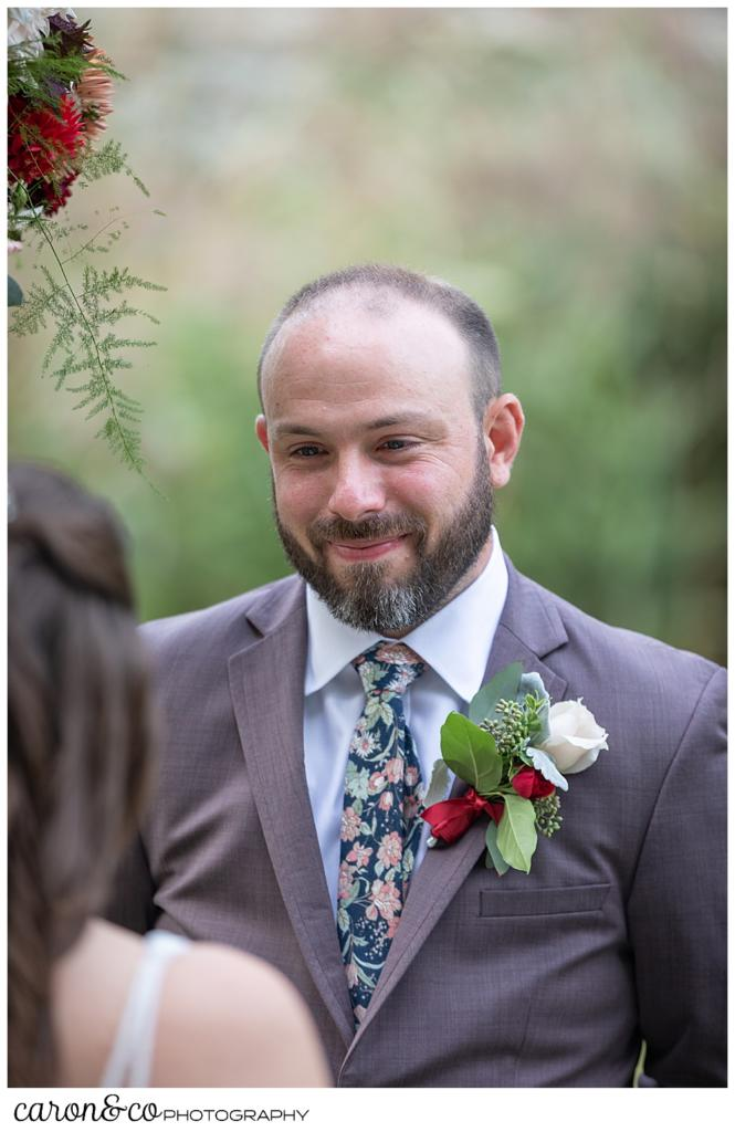 groom smiles at his bride during their charming kennebunkport Maine wedding