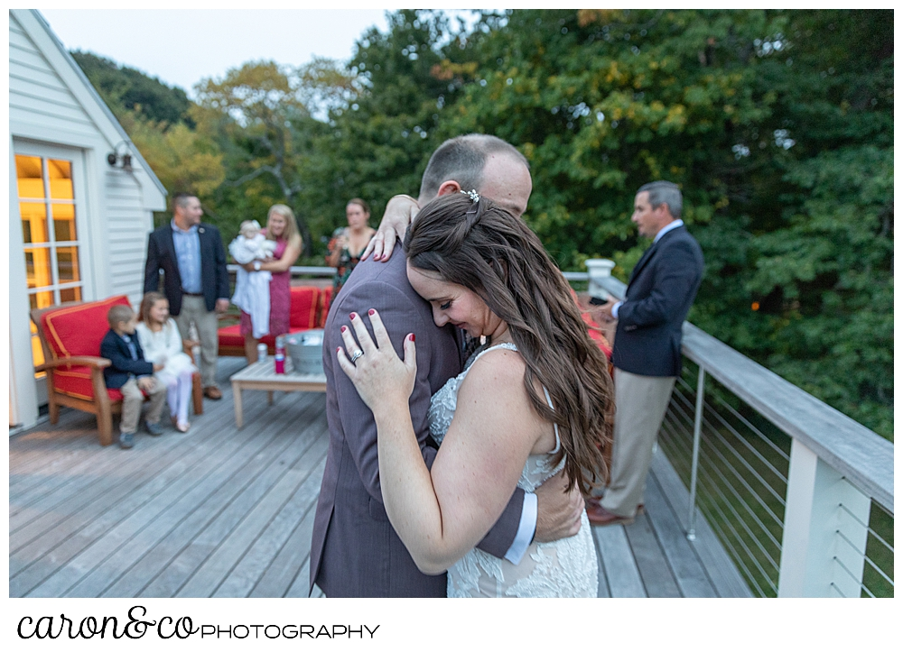 a bride and groom dance for the first time during their charming Kennebunkport Maine wedding reception