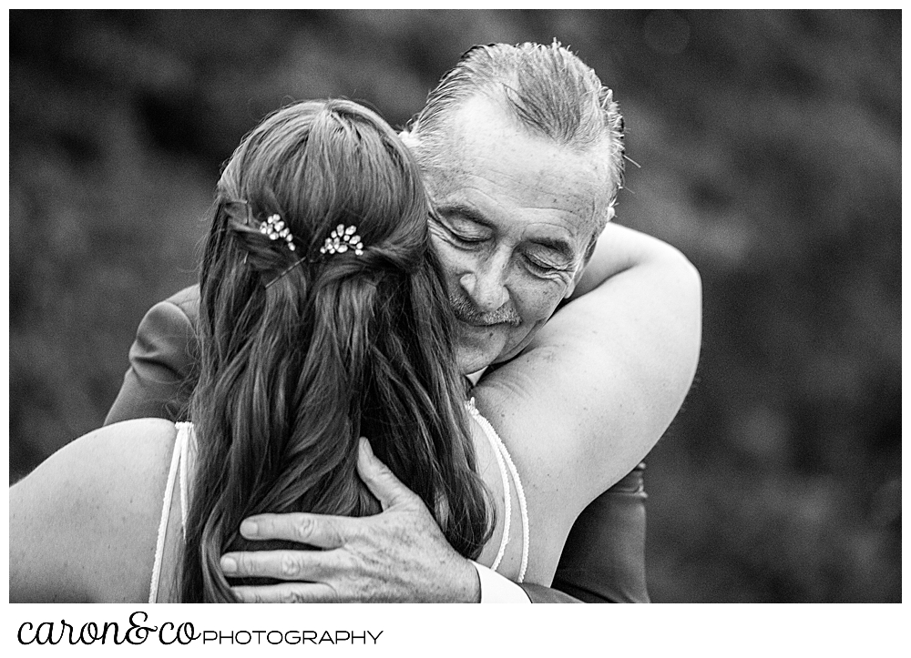 black and white photo of a father and daughter hugging