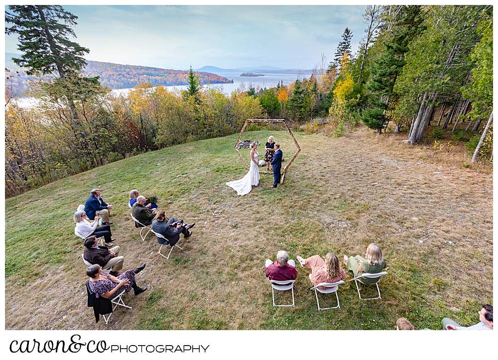 a wide photo of a Rangeley Maine wedding ceremony, with the western mountains in the background