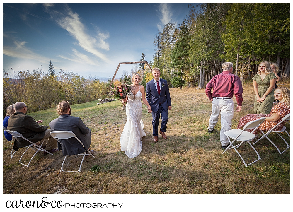 the bride and groom during the recessional at their Rangeley Maine wedding