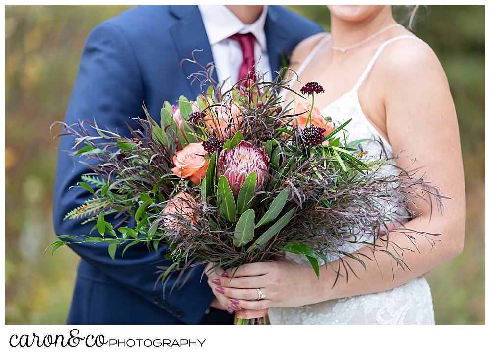 a bride's bouquet of peach roses and greens