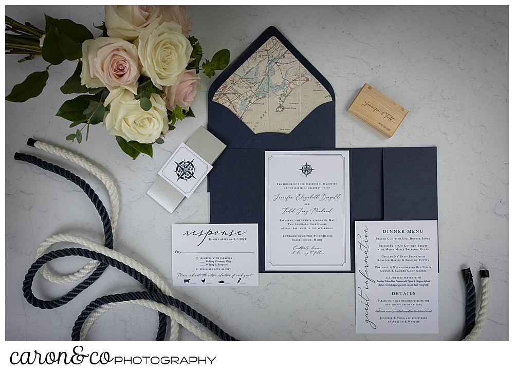 Wedding day details of a Pine Point Maine wedding, navy and white invitations, flowers, ring box, and white and navy rope