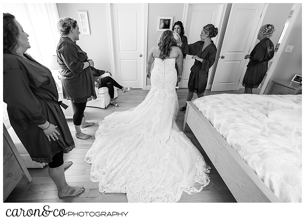 black and white photo of a bride getting ready for her wedding day