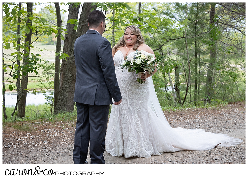 bride smiles at her groom during a Pine Point Maine wedding day first look
