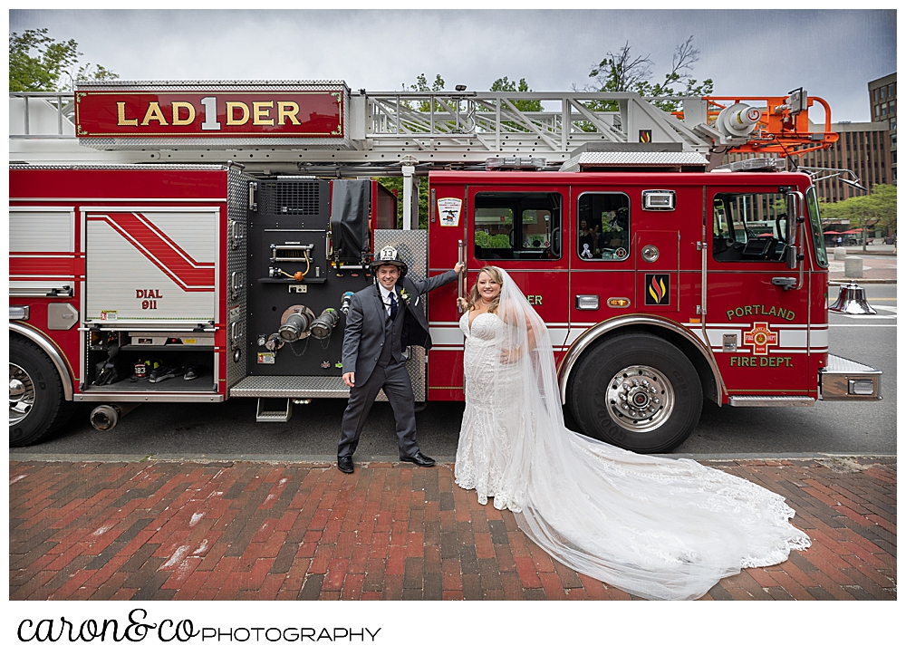 A bride and groom stand in front of Ladder 1 of the Portland, Maine fire department, Portland, Maine