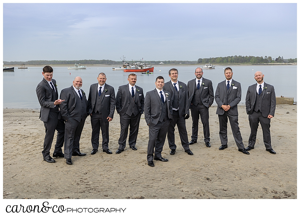 a groom and his groomsmen in gray, stand at Pine Point Beach, Scarborough, Maine
