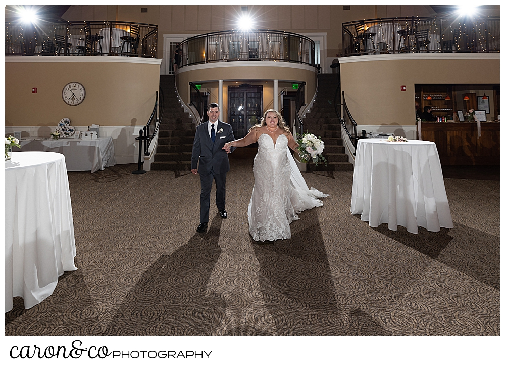 a bride and groom are announced in to their wedding reception at the Landing at Pine Point, Scarborough, Maine