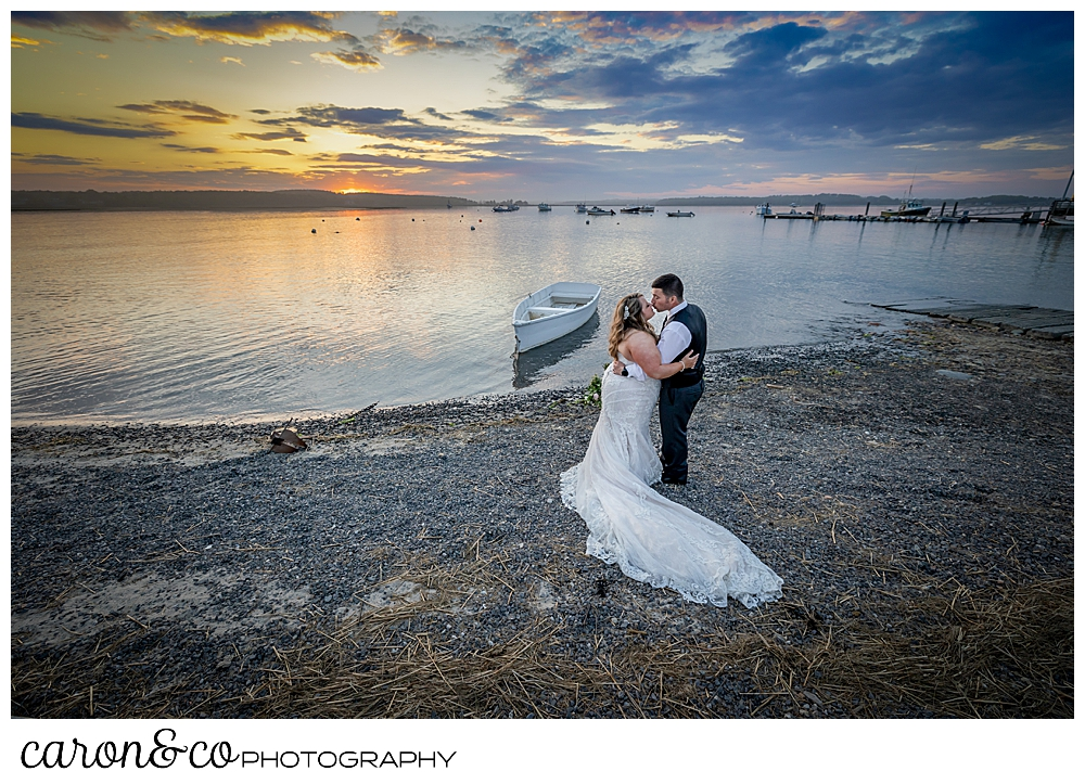 a bride and groom on the beach at Pine Point, Scarborough, Maine, during a beautiful sunset