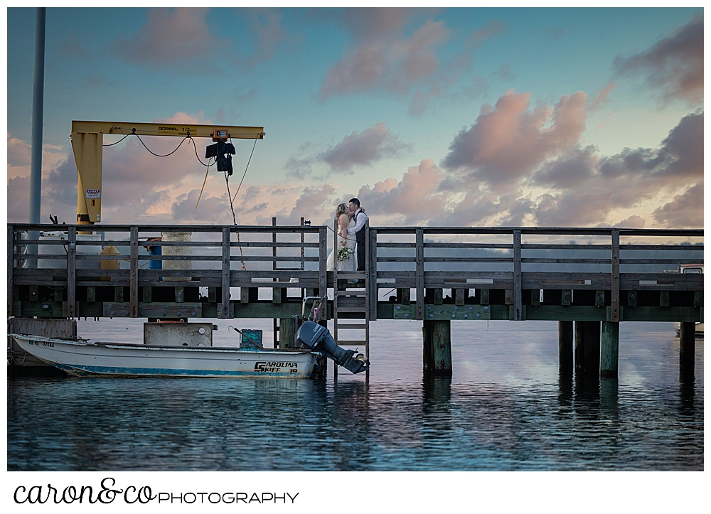 a bride and groom pose at the fisherman's coop at Pine Point Scarborough Maine