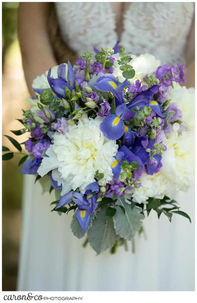 a beautiful blue, white, purple, and green bridal bouquet