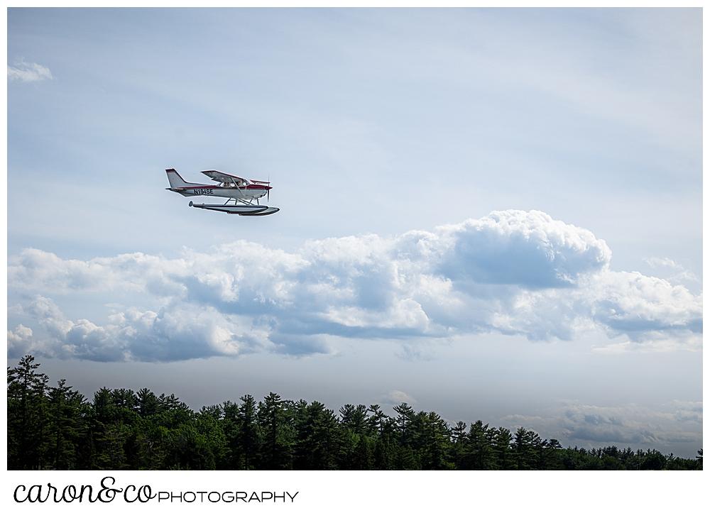 a float plane soars above Highland Lake, Bridgton Maine