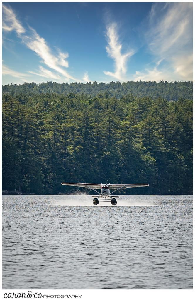 a sea plane lands on Highland Lake, Bridgton, Maine