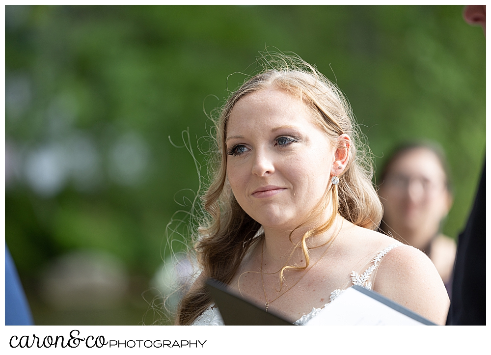 bride looking at groom during their Highland Lake Maine wedding ceremony