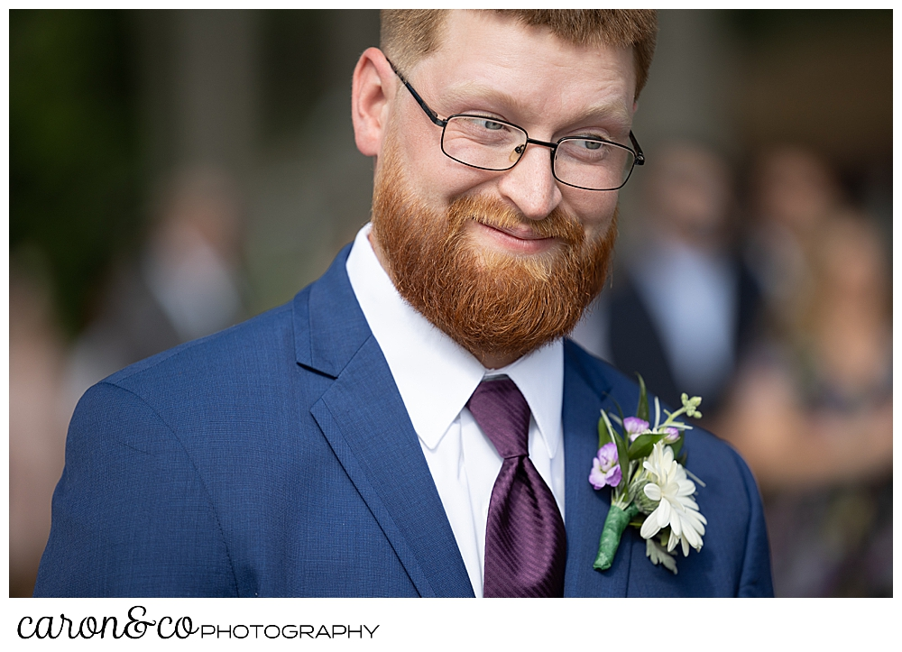 groom looking at his bride during their highland lake maine wedding ceremony