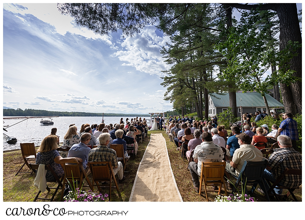 wide view of a highland lake maine wedding ceremony