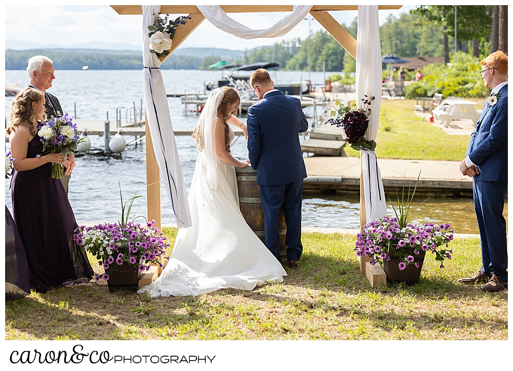 bride and groom during a sand ceremony at their highland lake maine wedding