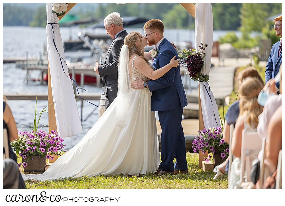bride and groom during the first kiss at their highland lake maine wedding