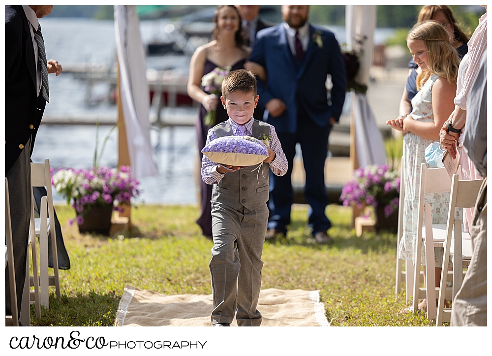 ring bearer during a highland lake maine wedding recessional