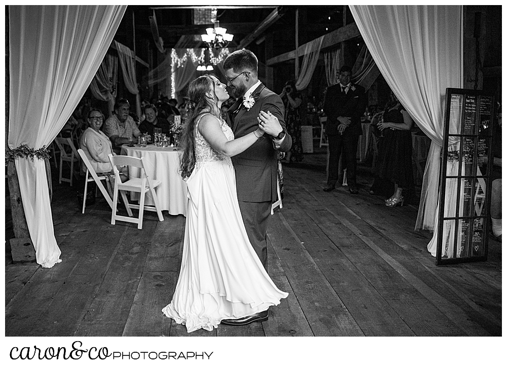 black and white photo of a bride and groom dancing their first dance