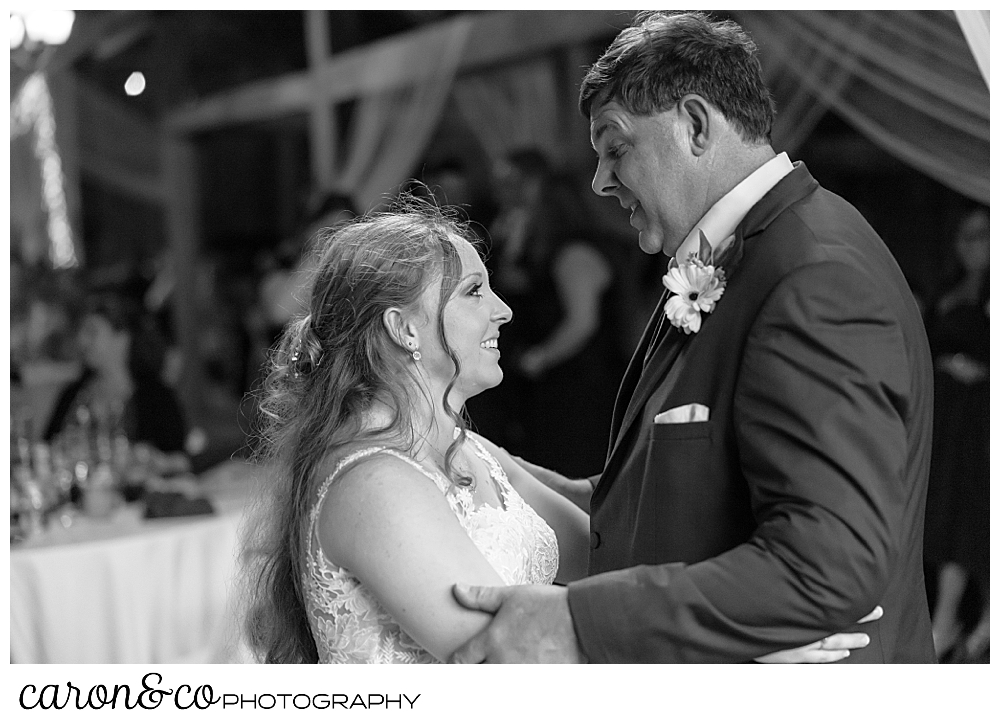 black and white photo of a bride and her father dancing together