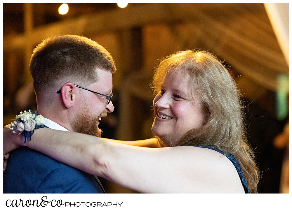 groom dancing with his mother at a highland lake maine wedding reception