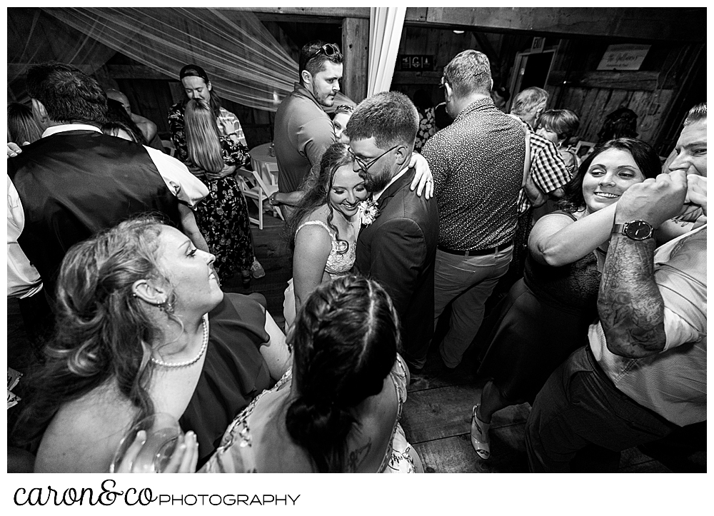 black and white photo of a bride and groom dancing during their Memory Lane Event Center, Harrison, Maine reception