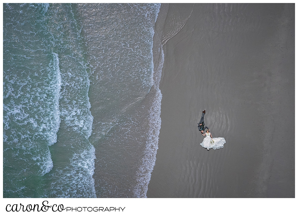 maine drone wedding photo of a bride and groom on the edge of Gooch's Beach, Kennebunk, Maine