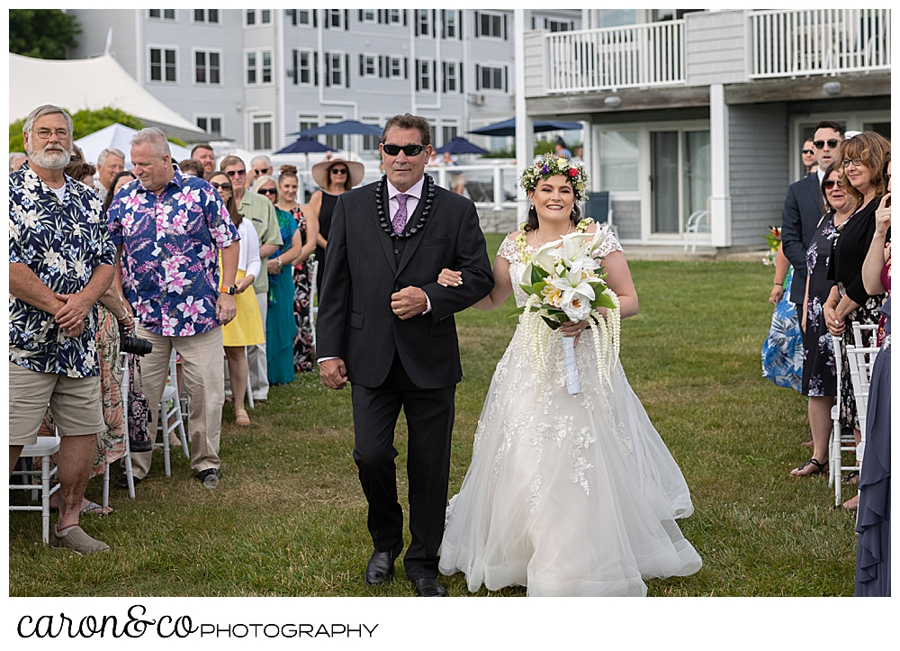 a bride and groom walk towards the groom, at their outdoor wedding at the Nonantum Resort, Kennebunkport, Maine