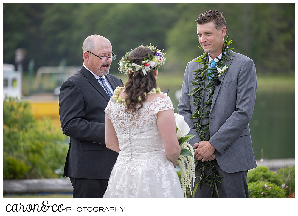 a groom looks at his bride during an outdoor wedding ceremony at the Nonantum Resort, Kennebunkport, Maine