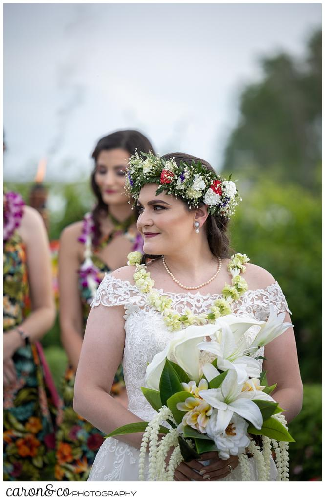 a bride standing at the outdoor ceremony site at the Nonantum Resort, Kennebunkport, Maine