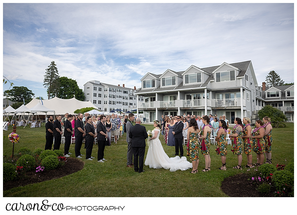 a wedding ceremony on the lawn with the Nonantum Resort in the background, Kennebunkport, Maine