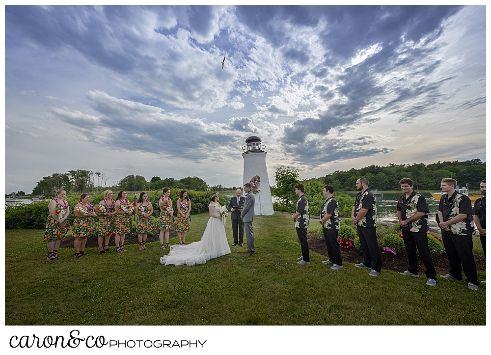a bride and groom and their wedding party at an outdoor wedding ceremony at the Nonantum Resort, Kennebunkport, Maine