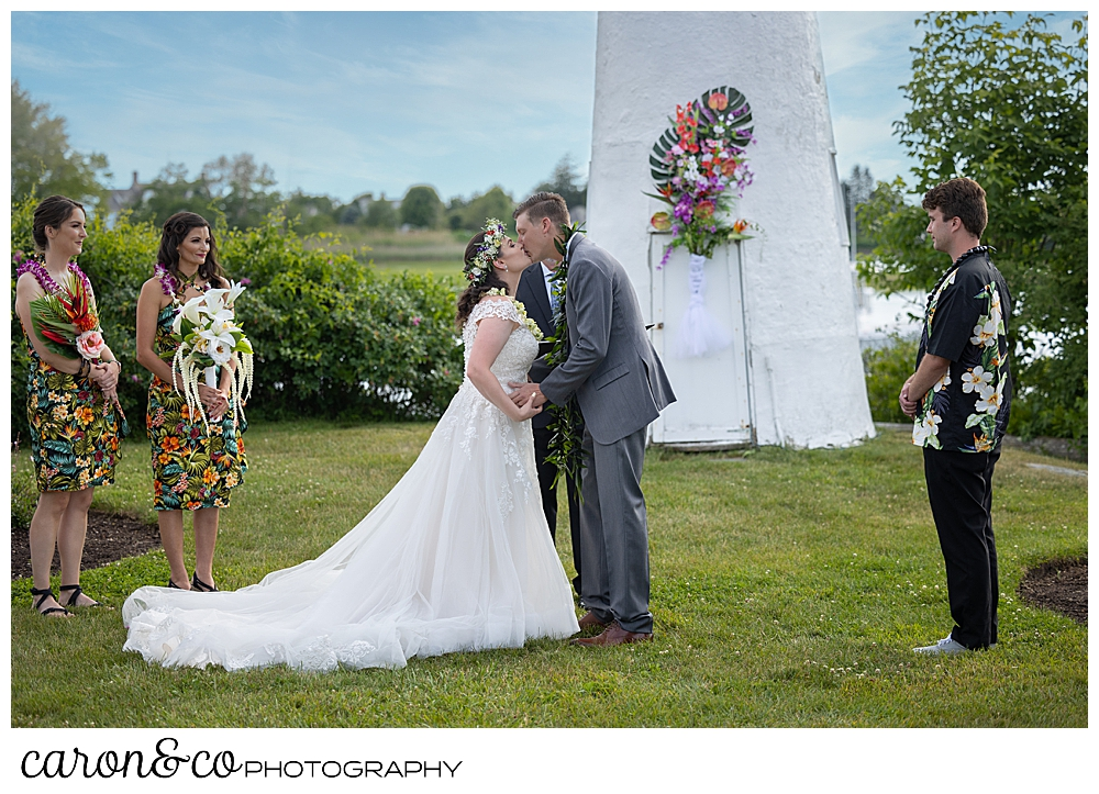 a bride and groom have their first kiss at a Nonantum Resort wedding ceremony, Kennebunkport, Maine