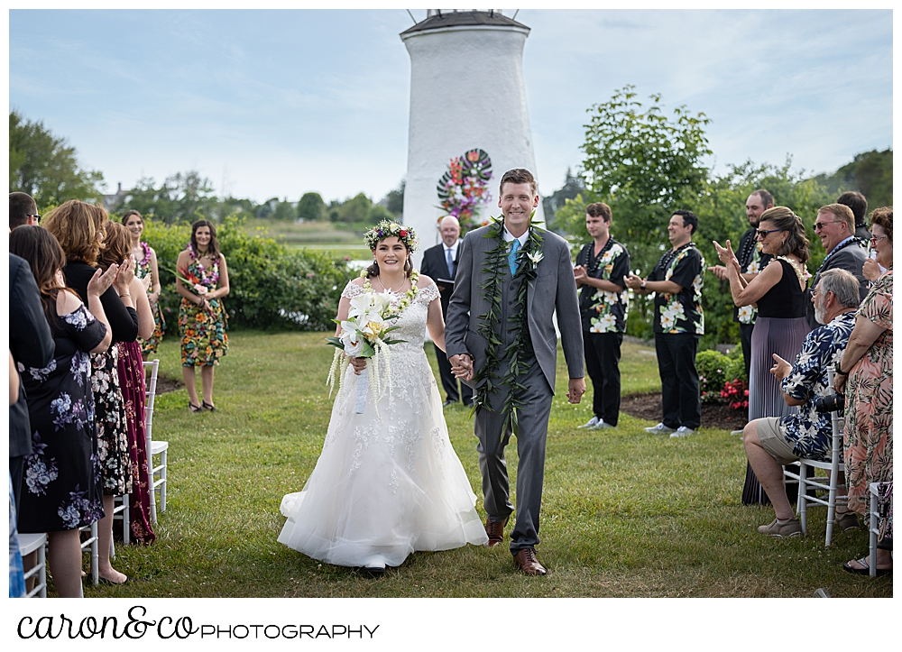 a bride and groom during their Nonantum Resort wedding recession, Kennebunkport, Maine