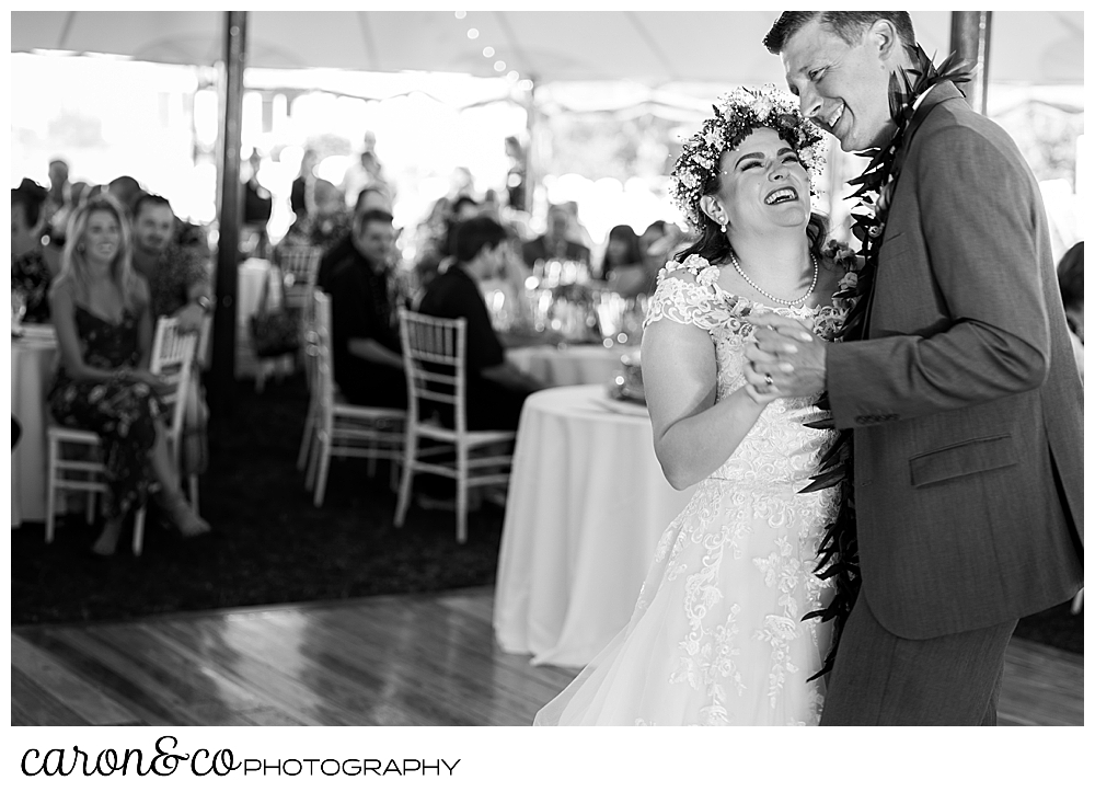 black and white photo of a bride and groom during their first dance at their Nonantum Resort tented wedding reception