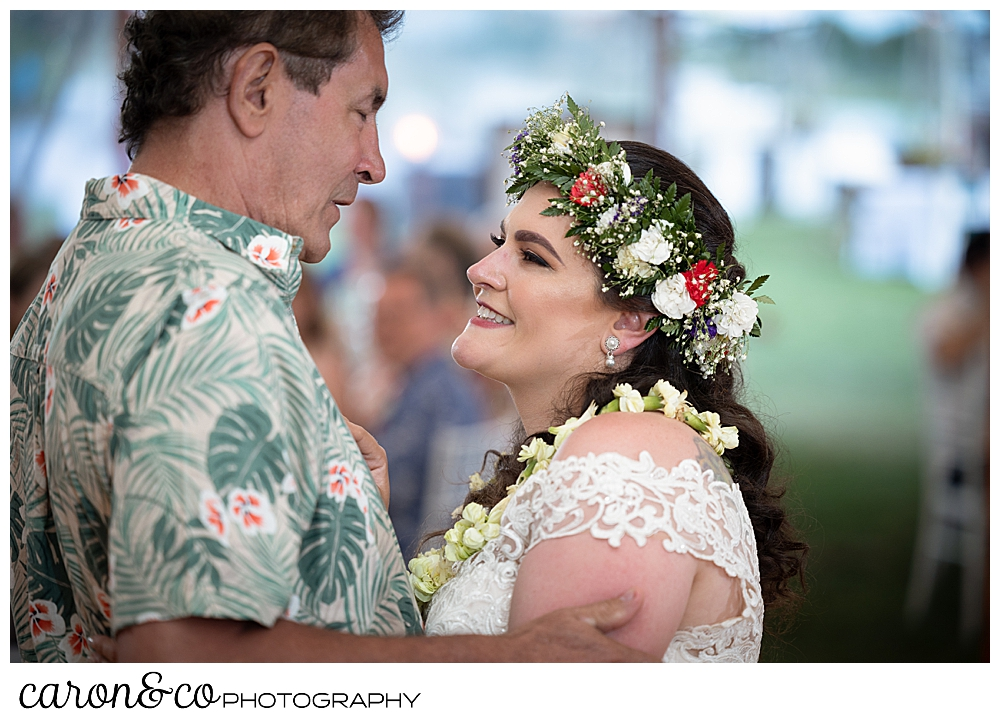 a bride dances with her father during the father daughter dance at a Nonantum Resort tented wedding reception
