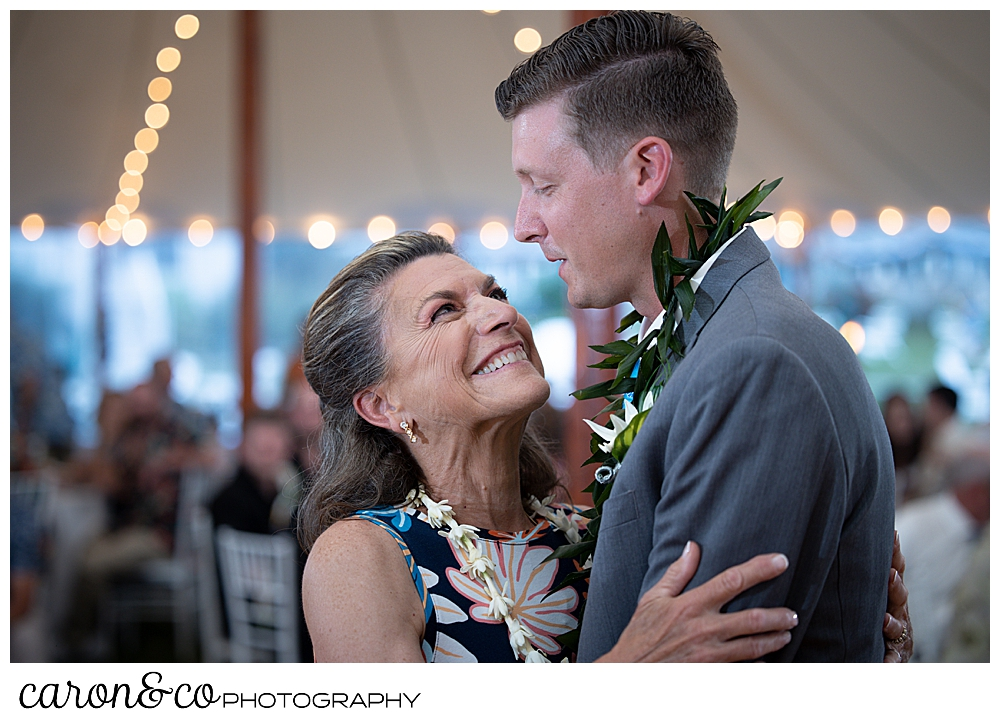 a groom dances with his mother during the mother son dance at a Nonantum Resort tented wedding reception