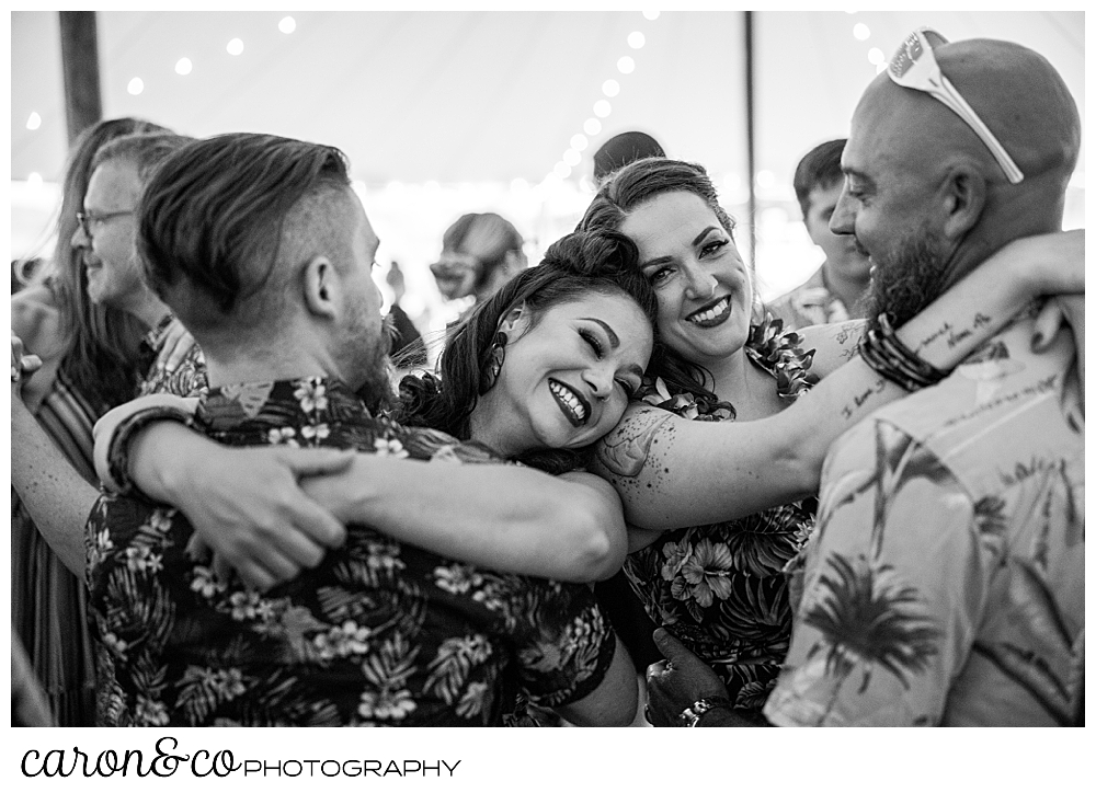 black and white photo of two couples dancing at a Nonantum Resort tented wedding reception