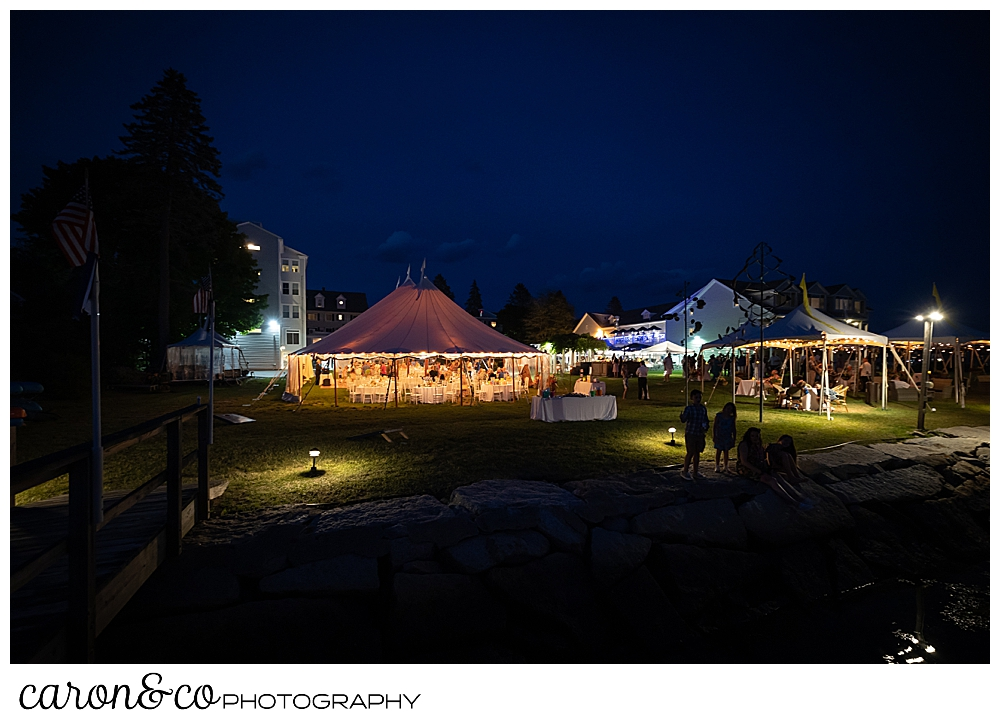 A tented wedding at the Nonantum Resort, Kennebunkport, Maine, glows in the summer twilight