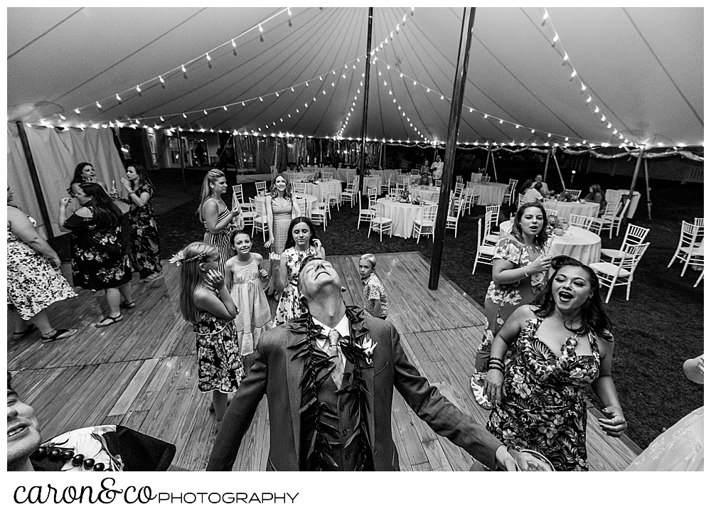 black and white photo of a groom dancing at his Nonantum Resort tented wedding reception